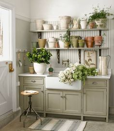 Potting shed in corner of garage: beadboard backsplash, shelves with decorative metal brackets--by Arnold M. Karp--photo by Dana Gallagher