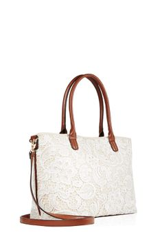 The classic tote gets a twist with Well Acquainted by JustFab.