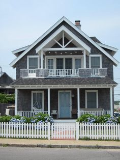 Grey shingle-style beach house with porch and porch swing. Beach Cottage Style, Lake Cottage, Future House, My House, Front Doors With Windows, Seaside Decor, Beach Cottages, Beach Houses, Cottage Exterior