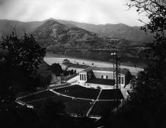 Aerial view of the Greek Theatre with the Hollywood Hills in the background, ca. The cornerstone was laid in 1928 and the building was officially dedicated on September 1930 Hollywood Boulevard, Hollywood Hills, Classic Hollywood, California History, Vintage California, Southern California, Los Angeles Hollywood, Griffith Park, City Lights