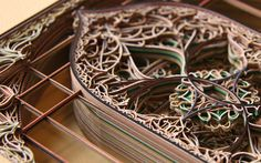 Eric Standley, a Virginia-based artist who works with laser-cut paper, creates amazing and awe-inspiring layered paper cuts of extraordinary complexity
