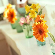 Colorful flowers - a simple touch to a hawaiian theme. @Dani Girl  we could dye mason jars blue and then put hawaiian flowers in them and decorate the jar with burlap and jute cord.