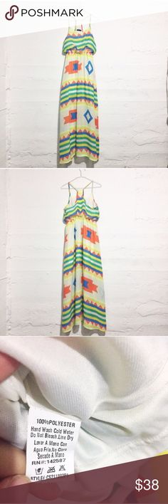 Racerback tribal inspired maxi dress Racerback tribal inspired maxi dress. This brightly colored tribal inspired pattern would be great paired with nude wedge sandals!  Open to offers. No trades Dresses Maxi