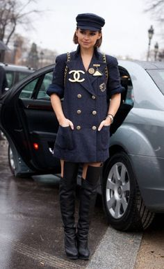 Miroslava Duma at Paris fashion week. Looking like a modern day Paula Abdul, Mira goes all out in a Chanel dress, baker boy cap and thigh-high boots.
