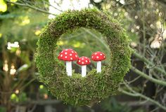 I have been seeing these little 'shrooms in a bunch of craft tutorials lately and I love them! Toadstool wreath tutorial. Could probably be made with supplies from Dollar Tree...
