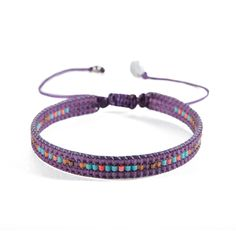 This purple bracelet is a lovely piece of jewellery made from handmade seed beads, both stylish and understated. Designed by Mishky.