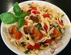 Fettuccine with a buttery fresh basil tomato sauce is a recipe for tender homemade pasta that's coated in a buttery white wine sauce with heirloom tomatoes and flecks of fresh basil. Fresh Tomato Basil Pasta is a true taste of summer with every forkful! Make an easy homemade pasta with basic ingredients that you have on hand, flour, eggs, olive oil and kosher salt, and while the pasta dough is resting you can prep the ingredients for my fresh summer tomato sauce.  No time for homemade pasta?…