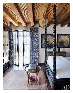 Patterned curtains stand out in this Mexican home's guest bedroom.