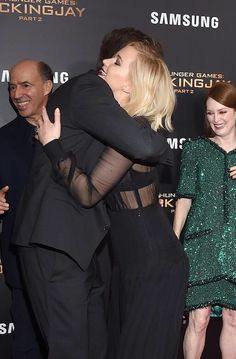 """Jennifer Lawrence and Liam Hemsworth at the premiere of """"Mockingjay part.2"""" in New York, 2015."""
