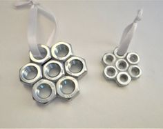 FREE SHIPPING! These metal snowman Christmas ornaments come in 2 types: one is made from washers, the other is made from nuts. Bother metal ornaments are superglued together. This ornament is a great gift for the handyman/handywoman in your life. Its simple design allows it to be compatible with many styles of home décor. The washer snowman measures 2.5in x 1.5in The nut snowman measures 2.5in x 0.5in.