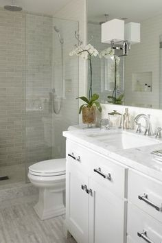 Contemporary 3/4 Bathroom with frameless showerdoor, George kovacs p470 wall sconce, Brick floors, Handheld Shower Head