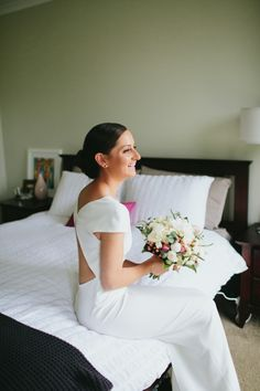 Dress by Carla Zampatti. Love the simplicity of it. The Vault: Curated & Refined Wedding Inspiration - Style Me Pretty
