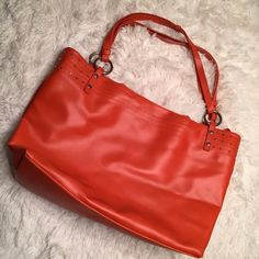 Orange Double Strap Tote from Avon Used a few times. In great pre-loved condition. Has been cleaned inside and out.  ✅ Bundle and save on shipping! ✅ All reasonable offers are considered.  ✅ I always ship right away.  ❌ PayPal ❌ Trades ❌ Lowballing Avon Bags