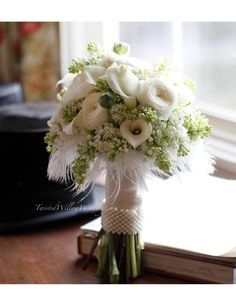 white feather bridal bouquet by TinyCarmen