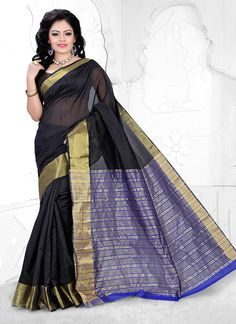 Be an angel and create and establish a smashing influence on everybody by carrying this black cotton   casual saree. The ethnic patch border work with the dress adds a sign of magnificence statement for your look. Comes with matching blouse.