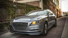 """Long-term 2015 Hyundai Genesis 3.8 Sedan Intro by AutoWeek - """"The car in stock form starts under $39,000 and comes, as they say, nicely equipped. On top of the 311-hp 3.8-L V6 and 8-speed automatic transmission, standard features include 9 airbags, rearview camera...push-button start, a trick hands-free trunk-opening feature...dual power-folding, heated side mirrors with puddle lamps projecting the Genesis name and logo like a pair of mini-Bat-Signals."""""""