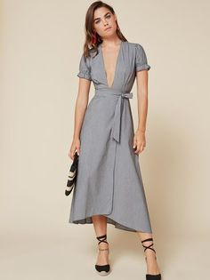 Just a little frills. This is an ankle length, wrap dress with a v neckline and elastic sleeve edge.