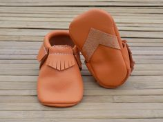 All of our moccs are made with a reinforced heel to prevent them from collapsing and an arrow grip strip on the bottom!
