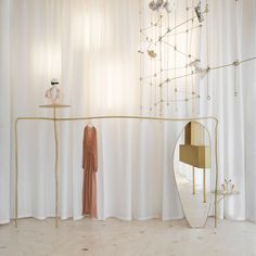 At boutique in Milan, the entrance and the front-facing window is guarded by a dramatic white curtain, which falls from the… Boutique Interior, Boutique Design, Home Decor Signs, Cheap Home Decor, Fashion Retail Interior, Interior Architecture, Interior Design, Decor Inspiration, Retail Store Design