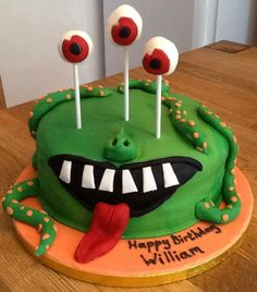 green Monster Cake - Simple vanilla sponge cake with cake pop eyes and fondant