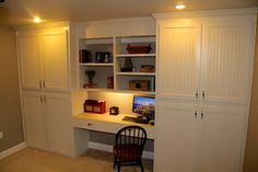 Custom built-in cabinets with desk traditional home office