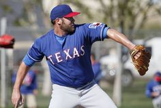 Texas Rangers pitcher Colby Lewis throws in a bullpen session before participating in live batting practice during a workout at the Rangers spring training facility in Surprise, Arizona Wednesday February 25, 2015. (Andy Jacobsohn/The Dallas Morning News)