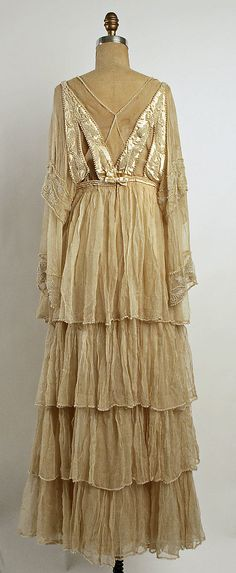 Wedding dress. Lucile (British, 1863–1935). Date: 1915. Culture: British. Mediums: silk, cotton, plastic, metal. Back view. MMA Collections.