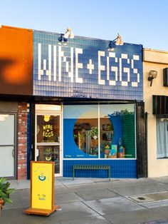 The tiled storefront of the grocery, which sells fine foods and natural wine, was also informed by the designer's travels. Atwater Village, Parisian Cafe, Checkerboard Pattern, Custom Made Furniture, Bespoke Furniture, Shop Fronts, Flower Stands, Wine And Spirits, Nails