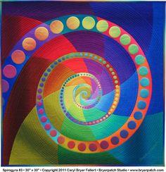 Spirogyra # 3 ... quilt by Caryl Bryer Fallert ... rainbow color spiral ... dots . swirl