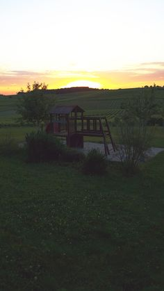 The last light of day : the children have left the swing. Parents can enjoy the vineyard at sunset | #sunset #cognac #vineyard #playground #guesthouse #bedandbreakfast #family #holidays #France