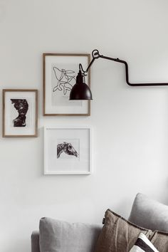 How to add colour to a monochrome home. Small picture wall idea for 3 pictures. #picturewall #minimalhome