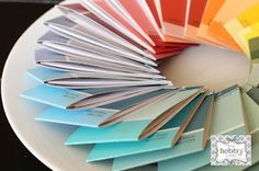 mini matchbook style notebooks covered in paint swatches!
