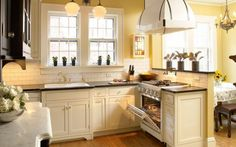 Gold and cream colored hues make this kitchen design glow