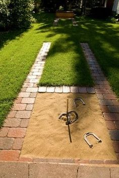 A backyard horseshoe pit designed with pavers blends seamlessly into this home's landscape.