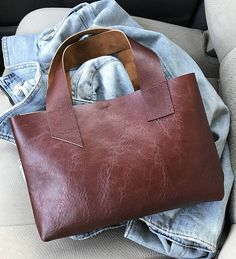 Handmade, Cognac Mini Leather Tote, metal snap closure and minimal design. Perfect no fuss bag! Length 7 1/2 inches Width 11 inches Strap 6 inch drop