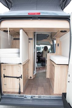 12 Camper Van Bed Designs For Your Next Van Build,Kitchen layouts. I love the design. This diy van life interior has the best aesthetic. Anyone who wants to build a camper. Transit Camper Conversion, Van Conversion Layout, Van Conversion Interior, Van Conversion With Bathroom, Van Conversion Shower, Van Conversion Kitchen, Sprinter Conversion, Camper Van Shower, Camper Van Kitchen