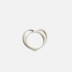 Simple yet eye-catching, this ring features a unique cut-out heart design. Handcrafted by local brand Bennt, it's constructed from 925 sterling silver. Note: This is a handmade jewellery piece, so the item may vary slightly from the image above.