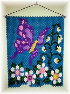 A very bright summery Butterfly Beaded Banner. size 15 X The colors are bright and colorful. Looks great hanging on a wall, door or in a window. Picture can be seen hanging in either direction. Pony Bead Crafts, Seed Bead Crafts, Beaded Crafts, Beaded Ornaments, Pony Bead Patterns, Beaded Jewelry Patterns, Peyote Patterns, Beading Patterns, Hexagon Quilt Pattern