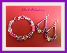 Pink and lilac wire wrapped bracelet & earrings. https://m.facebook.com/JulesLittleGems2011