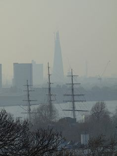 A view towards The Shard at London Bridge over the masts of the Cutty Sark at Greenwich from Greenwich Park