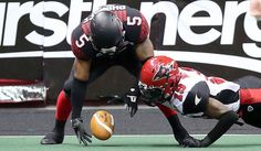Cleveland Gladiators' Joe Phinisee and Jacksonville Sharks' Maurice Williams fight for a fumbled ball. (Joshua Gunter/The Plain Dealer)