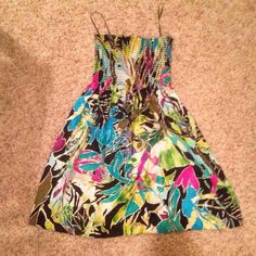 Cache multicolored dress Tube top style dress, very cute!  Large, but fits like a medium. I'm a size 7 Cache Dresses