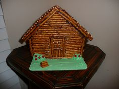 Presidents Day Craft. Abraham Lincoln Log cabin, made from Gingerbread house (After Christmas clearance) + Pretzel sticks and Chocolate Frosting.