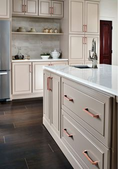 The Mulholland collection by Amerock focuses mostly on right angles and straight lines. The sleek rectangular knobs and cabinet pulls can work well with any cabinet in your home. There are a few rounded knobs and pulls, which look bold and edgy. Kitchen Cabinet Colors, Kitchen Colors, Beige Kitchen Cabinets, Kitchen Ideas, Cream Colored Kitchen Cabinets, Traditional Kitchen Cabinets, Soapstone Kitchen, Colonial Kitchen, Traditional Kitchens