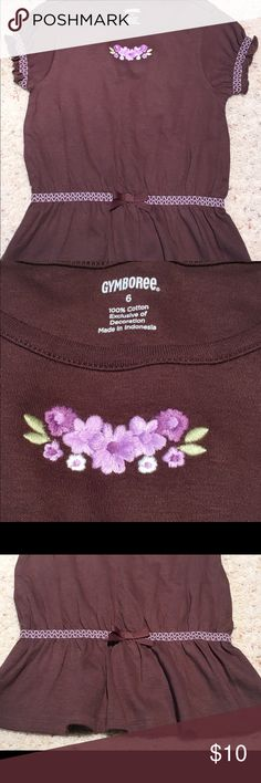 NWOT Gymboree Girls Top Size 6 Floral Adorable girls top in a size 6. New without tags. Never worn. It has beautiful purple flowers on the front and flare at the waist. Super cute! Please see the pictures and email me with any questions. Thanks for looking. 🌺 Gymboree Shirts & Tops