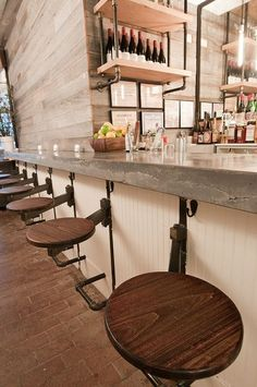 The Fat Radish | New York City   Raw edged cast in place countertop that extends over 50 feet, creating seating, service areas, a bar and a floating table at the end, cast 4 inches thick. By Oso Industries.: