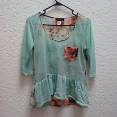 Teal and Floral 3/4 Sleeve Peplum Blouse Brand is Love 2 Be Loved, size small. This is slightly cropped, peplum style blouse, and well-loved. The bottom front has some major pulls in the fabric due to an unfortunate Velcro incident in the washing machine. Price reflects this. Please ask any and all questions before purchasing. Thanks! Love 2 Be Loved Tops Blouses