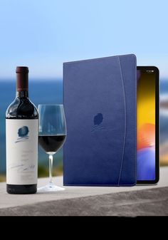 MacCase was asked by the world renowned Opus One Vineyards to create a series of custom Premium Leather iPad Pro cases. The cases would be used by Opus employees at their famous visitor center in Oakville California. MacCase created custom navy blue hides sewn with contrasting tan stitching. The Opus One logo embossed into the front cover completed the look. If you're an individual or company looking for custom iPad Pro cases, come and work with the world class team at MacCase. #customipadcase Opus One, Custom Ipad Case, Best Ipad, One Logo, Macbook Pro Case, Embossed Logo, Custom Leather, Ipad Pro, Vodka Bottle