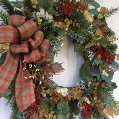 Christmas Wreath for Front Door-Winter Door Wreath-Holiday Door Wreath-Berry Wreath-Woodland Winter Wreath-Farmhouse Christmas Wreath  This sophisticated yet natural-looking wreath is loaded with realistic evergreen boughs, bronze seeded eucalyptus, birch leaves, grape ivy and eucalyptus. The addition of silver-gray dusty miller and frosted cedar adds light and movement to the design. A sprinkling of cream pip berries and hydrangea peek through the abundant foliage. Clusters of tiny red…