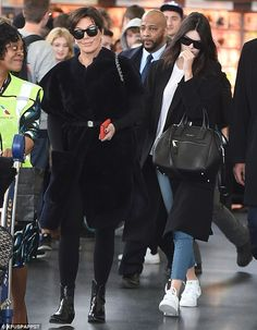 Coordinating: Kendall Jenner (R) and her momager Kris Jenner (R) sported similar, long bla...